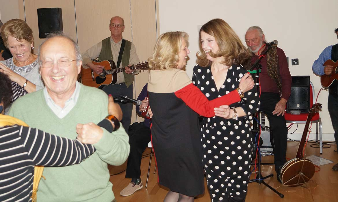 friends dance at irish event